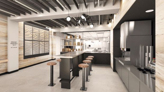 When collecting their order, customers can take a look at the Chipotle kitchen.